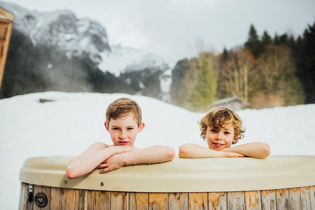 photoshoot for a family after ski hot tub in the chalet in Morzine Avoriaz (French Alps) on their ski holiday
