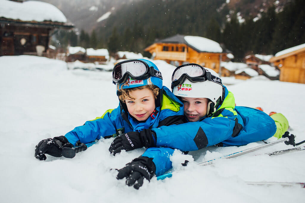 photoshoot for a family two brothers playing in the snow in Morzine Avoriaz (French Alps) on their ski holiday