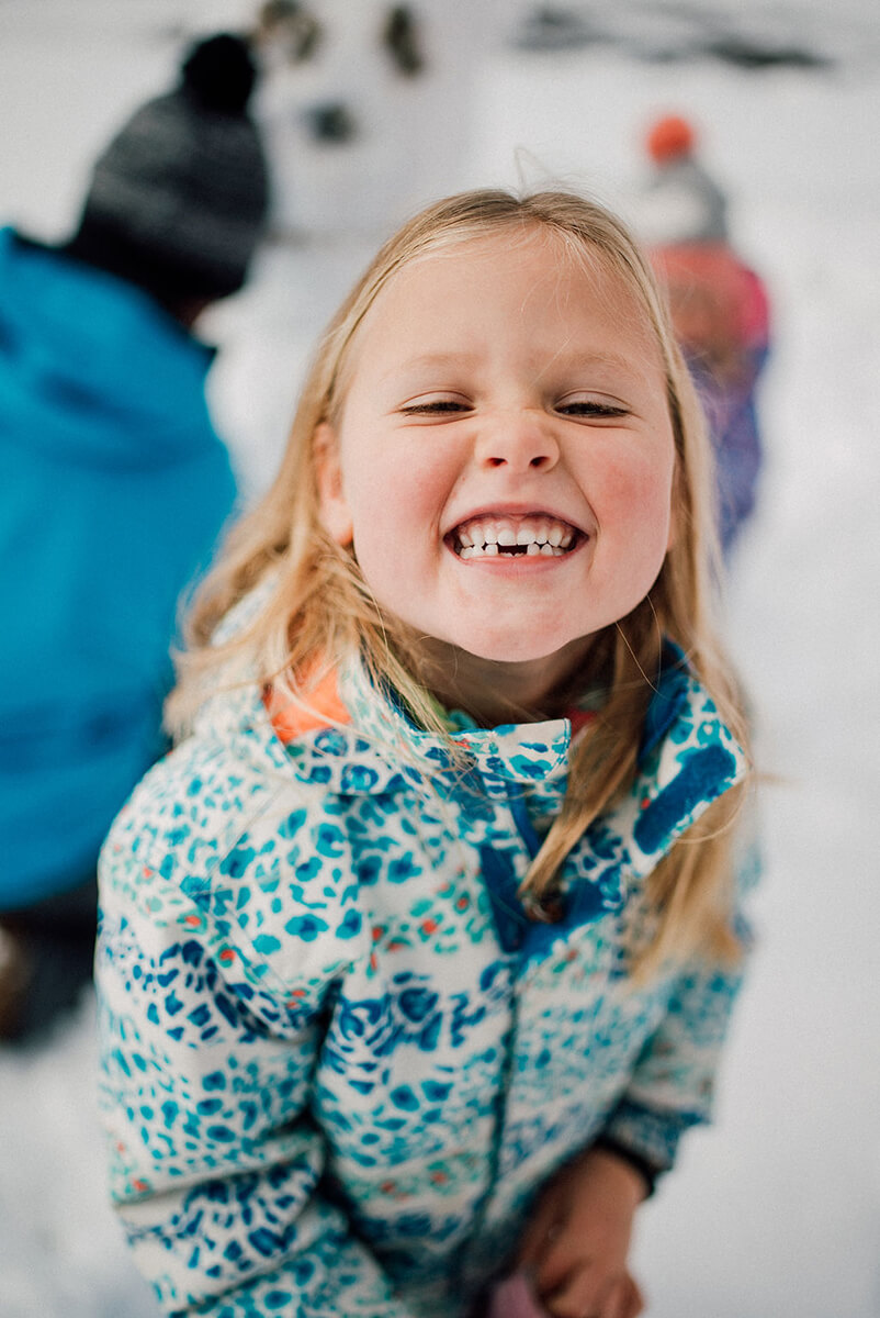 photoshoot for a family a girl playing with a snow in Avoriaz (French Alps) on ski holiday