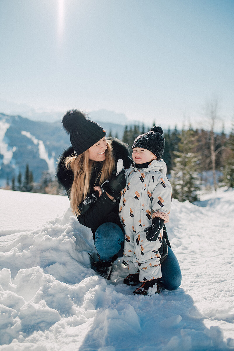 mom and kid snow sledge first time snow winter led gets french alps
