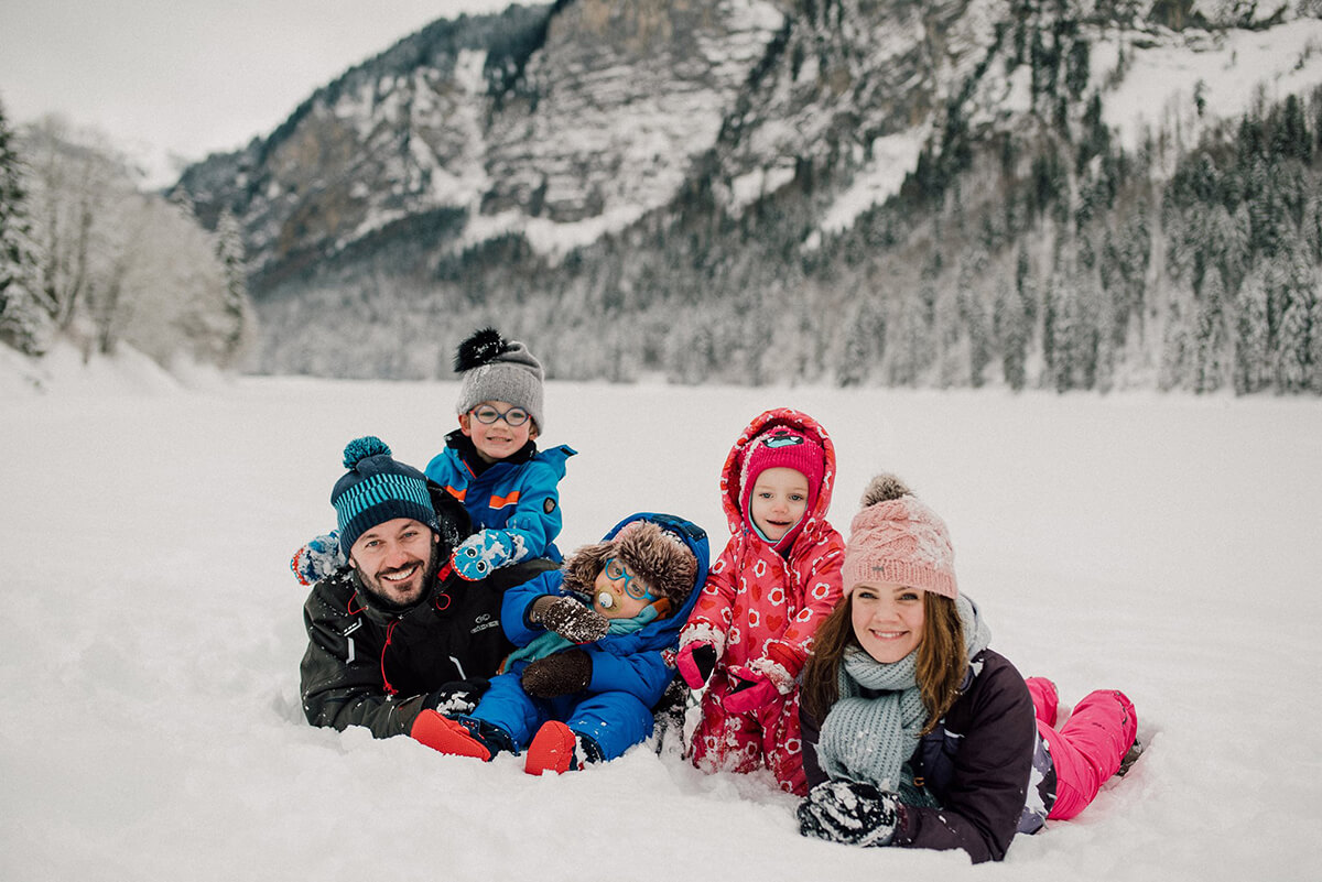 family kids sledge snow winter led gets french alps lac montriond
